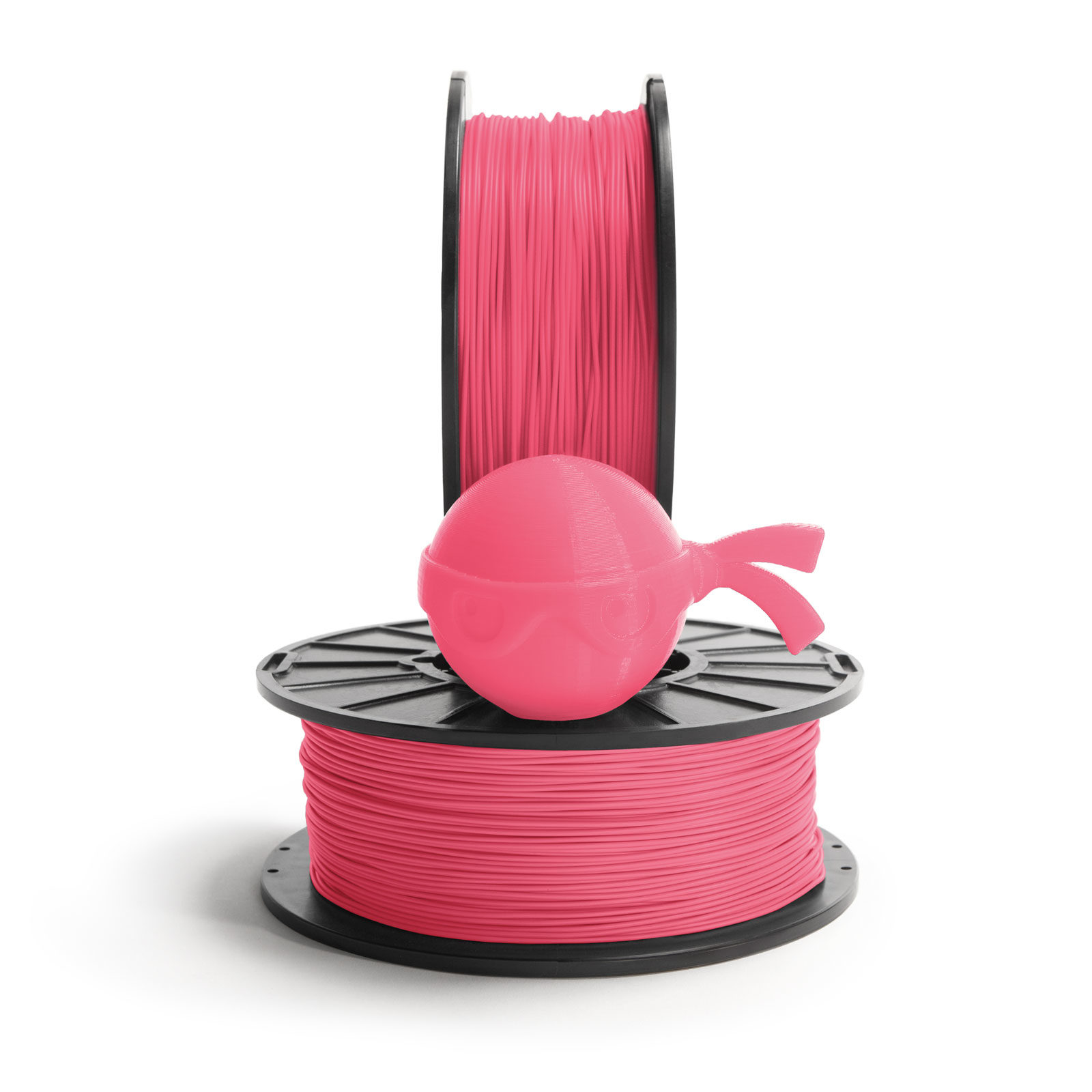 Flamingo pink ninja head sitting on NinjaTek 3D printing filament spool