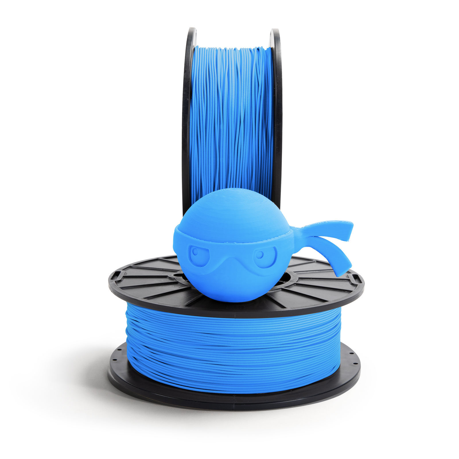 Sky blue ninja head sitting on NinjaTek 3D printing filament spool